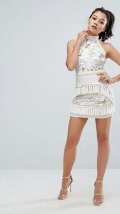 http://www.asos.com/prettylittlething/prettylittlething-premium-halterneck-sequin-tassel-bodycon-dress/prd/7943440?CTARef=Saved%20Items%20Image