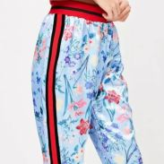 https://www.missguided.co.uk/blue-satin-floral-trousers-10052569